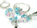 Set bijuterii, argint rodiat, aspect aur alb, patru piese, topaz bleu si roz si zirconii